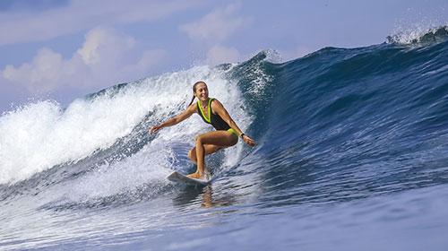 Woman surfing in Bali